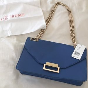 Ivanka Teump Gorgeous blue clutch with chain!